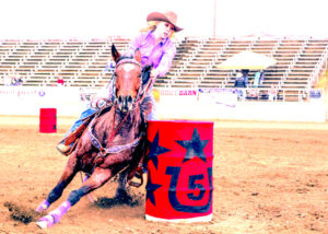 Woman on horse during barrel race
