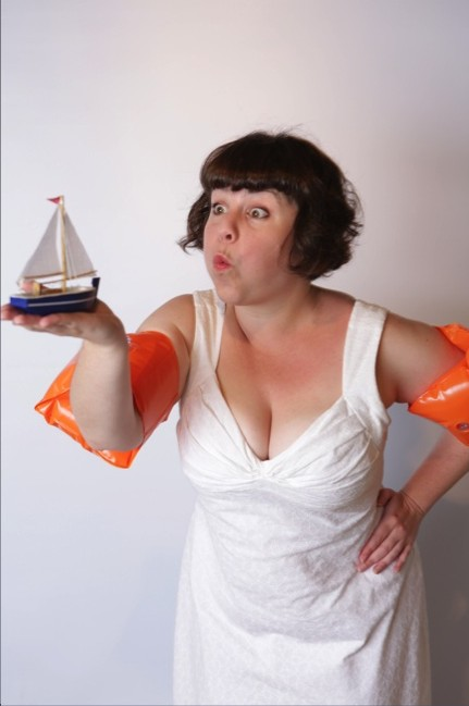 "Megan Cohen says ""Take Me Home"" for the Odyssey by Blowing the Sail of a tiny boat"