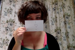 """It's me holding up a sign that says """"I <3 U"""""""